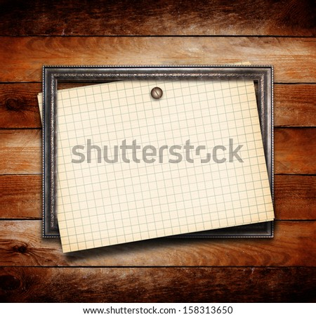 Old gilded wooden frame on grange wall - stock photo