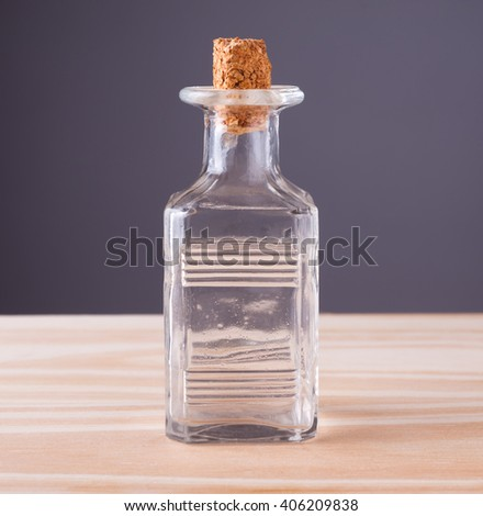 Old glass bottle on wooden table. - stock photo