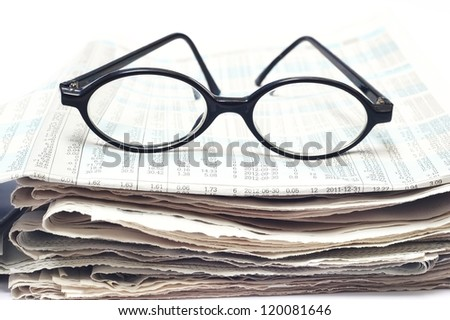 old glasses on newspaper