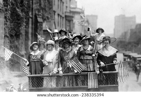 Old Glory. Group of women standing on top of vehicle waving flags, New York City, ca. 1907-1916