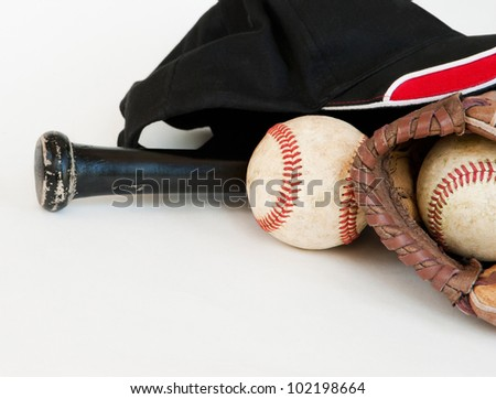 old glove, bat and baseballs isolated on white with copy space - stock photo
