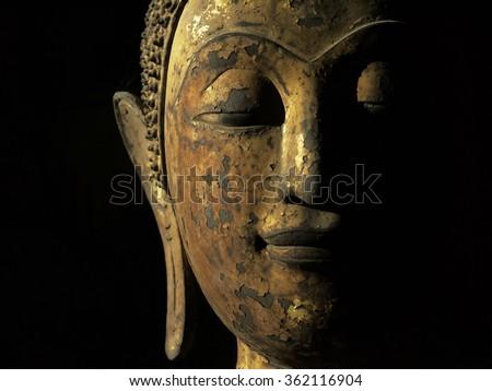 old gold buddha face - stock photo
