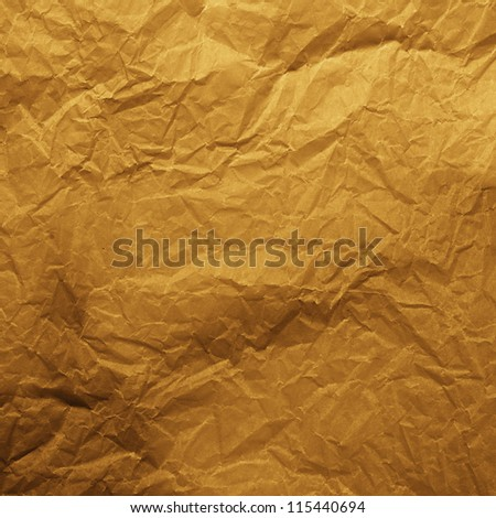 Old gold crumpled paper texture - stock photo