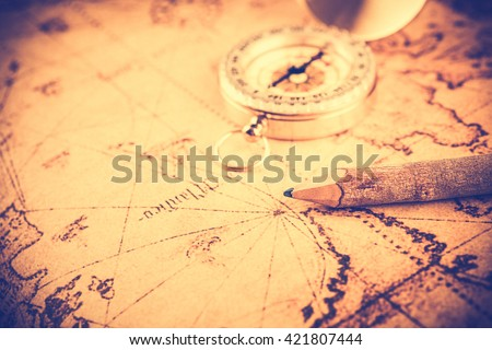 Old  gold vintage compass and pencil on vintage map;vintage tone style - stock photo
