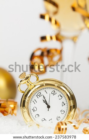 Old golden clock close to midnight and sparkling Christmas decoration - New Year concept - stock photo