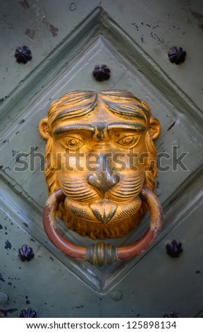 Old golden door handle - stock photo