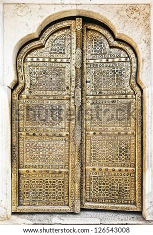 Old Golden Doors of the Hawa Mahal. Hawa Mahal, the Palace of Winds in Jaipur, Rajasthan, India. - stock photo