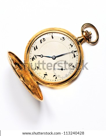 Old golden pocket watch on white background - stock photo
