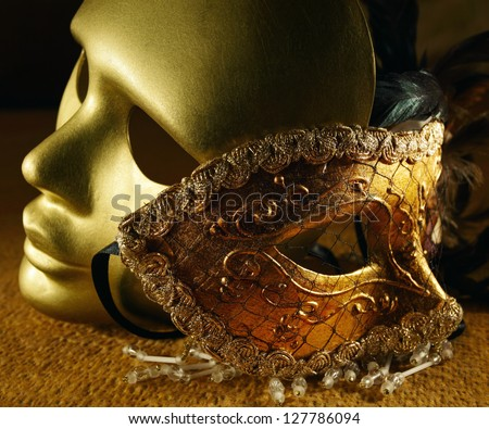 Old golden Venetian masks , focus on a center - stock photo