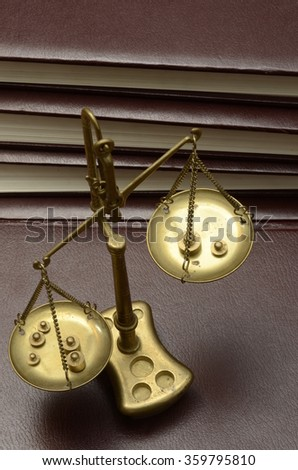 Old Golden weighing scale balance - stock photo