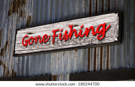 Old gone fishing sign. - stock photo