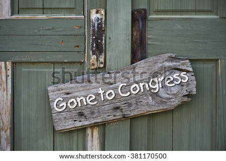 Old gone to congress sign on green doors. - stock photo