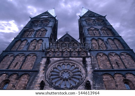 Old Gothic cathedral and the mysterious dark sky - stock photo