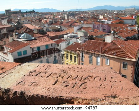 Old grafitti (1916) on a tower overviewing the city of Perpignan in the south of France (horizontal) - stock photo