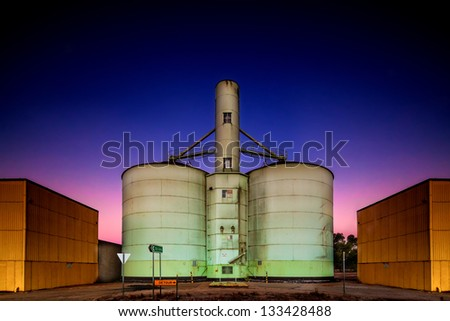 Old grain storage rustic silo during a stunning pink purple blue dusk sunset in country Victoria of Australia - stock photo