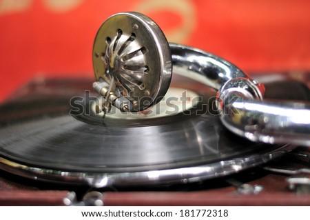Old gramophone head and vinyl disc. - stock photo