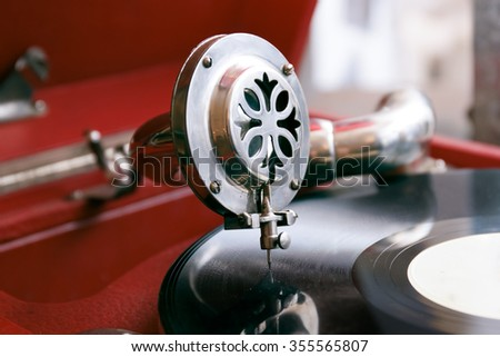 old gramophone plays a record