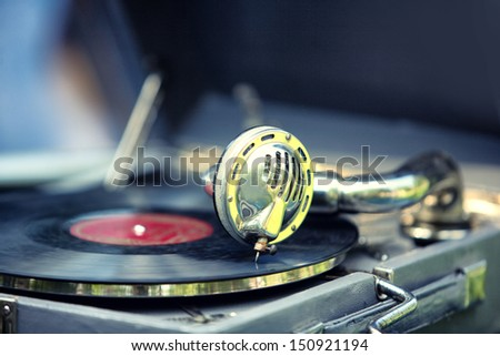 Old gramophone with record - stock photo