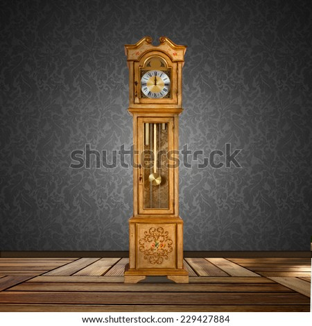 Old grandfather clock isolated in a empty room. - stock photo