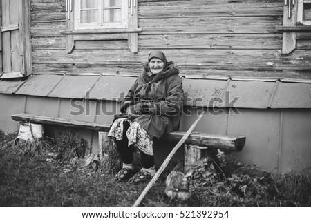 old grandmother near his home in Russia 1