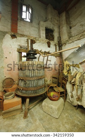 Old grapes press, machine for pressing and making wine - stock photo