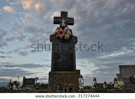 Old grave at the cemetery - stock photo