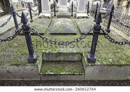 Old graves in a cemetery, detail of a Christian place, death - stock photo