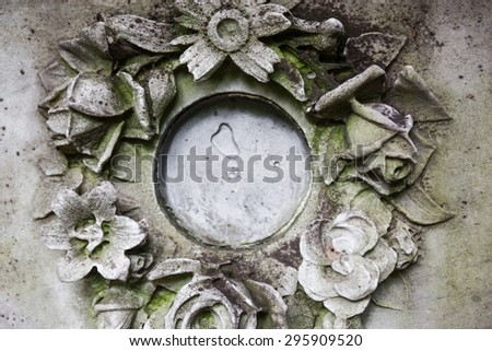 Old gravestone missing the portrait of the buried person - stock photo