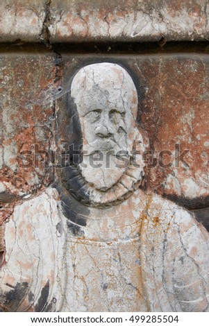 Old gravestone of the Renaissance nobleman on church wall
