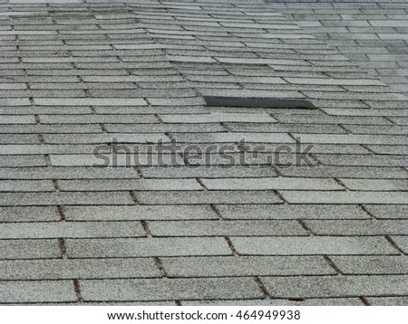 Old gray asphalt shingle roof