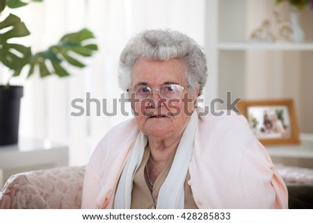 Old gray-haired woman with glasses