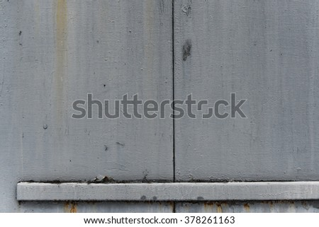 Old gray paint on grunge  metal surface