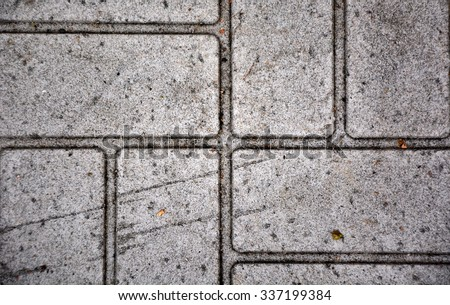 Old gray pavement. Picture can be used as a background - stock photo