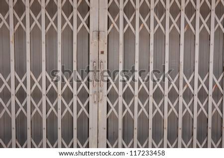 old gray steel door. - stock photo