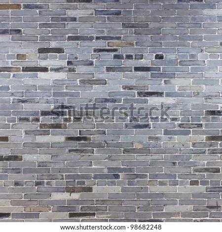 Old gray stone brick wall - stock photo
