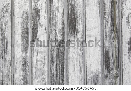 Old gray wood detail of a wooden background texture