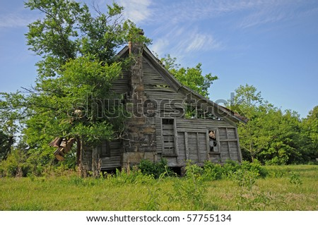 old gray wooden cabin with chimney of yesteryear