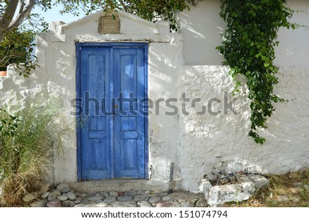 Old Greek House with blue door - stock photo