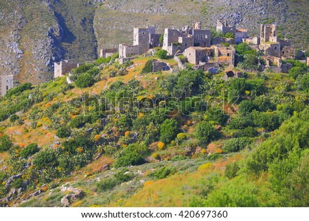 Old Greek village with stone houses in Vatheia, Greece - stock photo