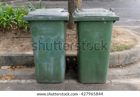 Old green bins - stock photo