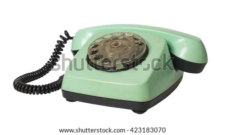 Old green disk phone isolated on a white background