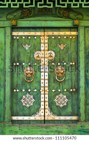 Old green door of Chinese house - stock photo