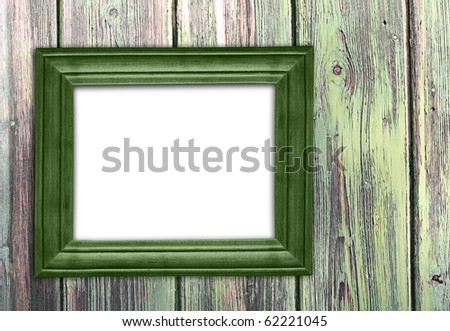 Old green frame on old wooden wall. - stock photo