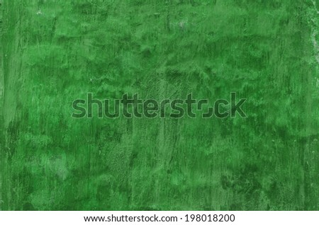 old green grunge wall with a cracks - stock photo