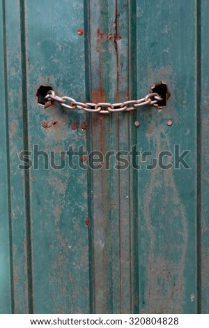 old green iron door - stock photo