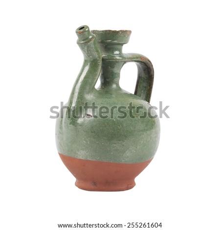 Old green jug - stock photo
