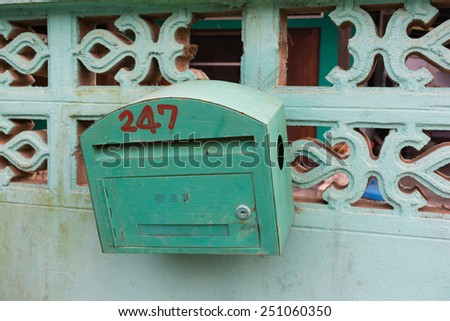 Old  Green Letter Box on the wall - stock photo