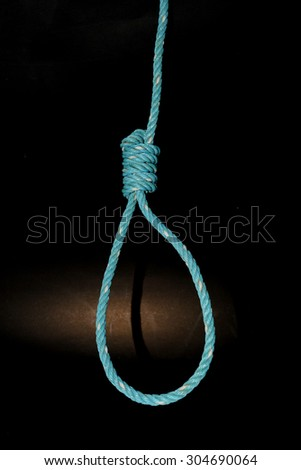 Old Green loop the nylon rope Tie on black background - stock photo