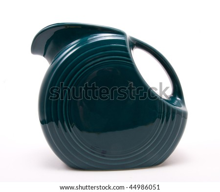 Old green retro vintage jug isolated against white background.