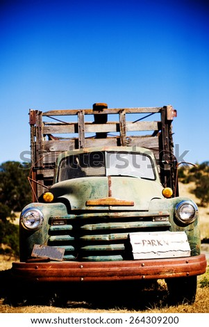 old green rusted truck in field - stock photo